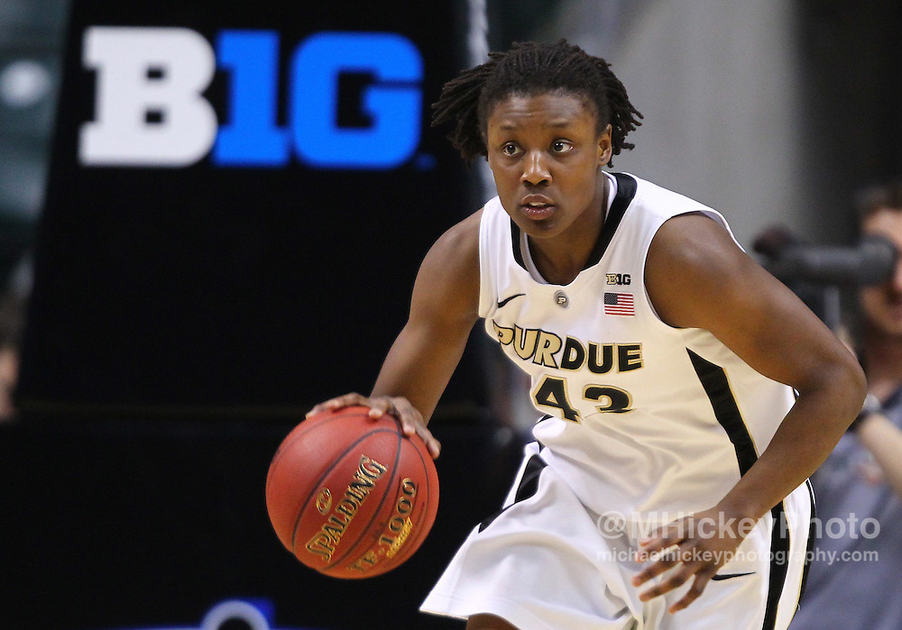 March 04, 2012; Indianapolis, IN, USA; Purdue Boilermakers guard Chantel Poston (43) brings the ball up court against the Nebraska Cornhuskers during the finals of the 2012 Big Ten Tournament at Bankers Life Fieldhouse. Purdue defeated Nebraska 74-70 in 2OT. Mandatory credit: Michael Hickey-US PRESSWIRE
