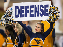 Nov 4, 2017; Morgantown, WV, USA; A West Virginia Mountaineers cheerleader holds a sign during the fourth quarter against the Iowa State Cyclones at Milan Puskar Stadium. Mandatory Credit: Ben Queen-USA TODAY Sports