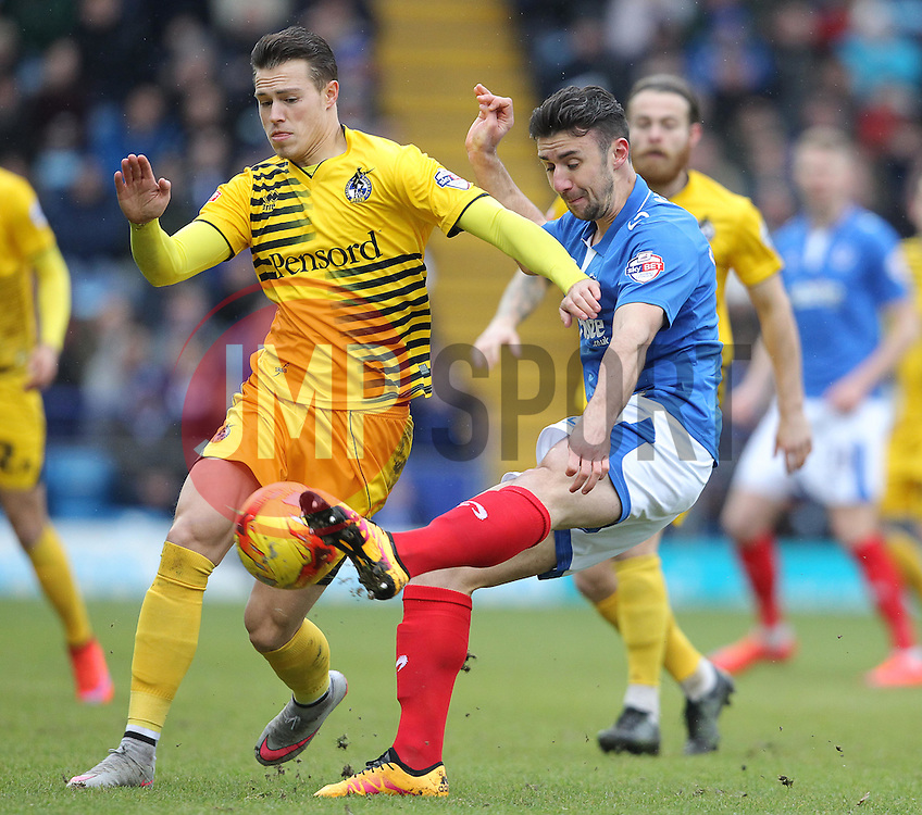 Enda Stevens of Portsmouth and Billy Bodin of Bristol Rovers challenge for the ball - Mandatory byline: Paul Terry/JMP - 13/02/2016 - FOOTBALL - Fratton Park - Portsmouth, England - Portsmouth v Bristol Rovers - Sky Bet League Two