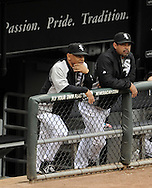 CHICAGO - MAY 21:  Bench coach Joey Cora #28 (L) and manager Ozzie Guillen #13 (R) of the Chicago White Sox look on from the dugout during the game against the Los Angeles Dodgers on May 21, 2011 at U.S. Cellular Field in Chicago, Illinois.  The White Sox defeated the Dodgers 9-2.  (Photo by Ron Vesely)  Subject:   Joey Cora;Ozzie Guillen