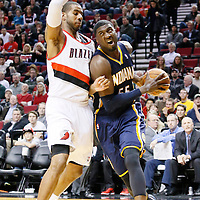 02 December 2013: Indiana Pacers center Roy Hibbert (55) drives past Portland Trail Blazers power forward LaMarcus Aldridge (12) during the Portland Trail Blazers 106-102 victory over the Indiana Pacers at the Moda Center, Portland, Oregon, USA.