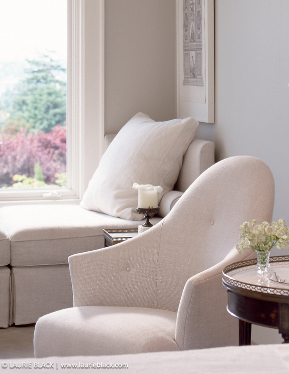 White bedside chair and window seat.