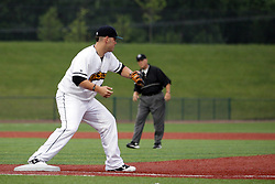 09 June 2011: Steve Alexander handles a throw to first base during a game between the Lake Erie Crushers and the Normal Cornbelters at the Corn Crib in Normal Illinois.