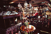 Forbes Island, a man-made floating island home in San Francisco Bay, Sausalito, California. Forbes Kiddoo at his bar.