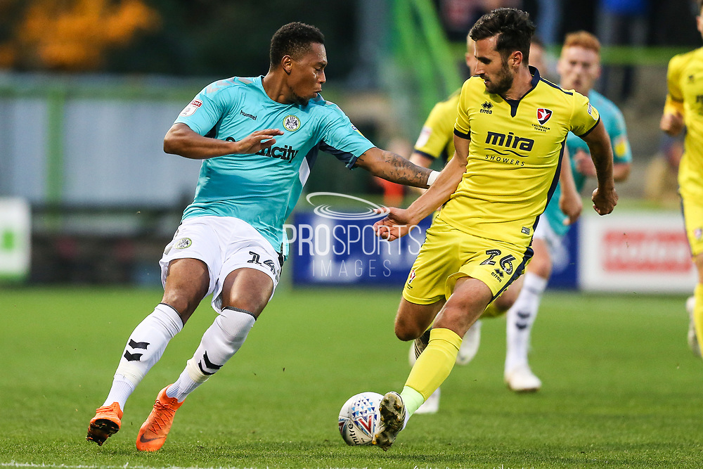 Forest Green Rovers Tahvon Campbell(14) and Cheltenham Town's Chris Clements(26) during the EFL Trophy match between Forest Green Rovers and Cheltenham Town at the New Lawn, Forest Green, United Kingdom on 4 September 2018.