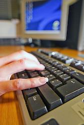 Woman using computer UK