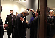 Newt Gingrich has his hair brushed by personal assistant Andrew Bell before speaking at Insight Technology in Londonderry.  <br /> <br /> Day on the Campaign Trail with Newt Gingrich; Monday, December 12, 2011. <br /> <br /> (Alexander Cohn/ Monitor Staff)