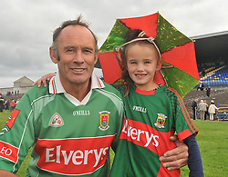 Vincent McAndrew from Lahardane with his grand daughter Lily Gannon aged 6 celebrating Mayo's Connacht Final win over Sligo on sunday.<br /> Pic Conor McKeown