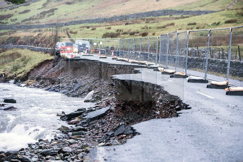© Licensed to London News Pictures. 18/03/2016. Cumbria UK. File picture shows the A591 in Ambleside damaged by storms last December. The Department for Transport has pledged an additional £82.6m today to fund essential repairs to infrastructure in Cumbria damaged by Storms Desmond & Eva last December. Photo credit: Andrew McCaren/LNP