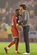 Gabriele Cioffi, Head Coach of Crawley Town FC celebrates the win with Panutche Camara (Crawley Town)  following the EFL Cup match between Crawley Town and Norwich City at The People's Pension Stadium, Crawley, England on 27 August 2019.