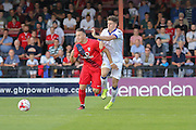 Josh Carson is fouled during the Friendly match between York City and Leeds United at Bootham Crescent, York, England on 15 July 2015. Photo by Simon Davies.