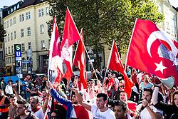 19.10.2014, Muenchen, GER, Aufmarsch von tuerkischen Nationalisten gegen die PKK, Der Rockerclub 'Turkos MC' rief zu einer Demonstration gegen die PKK auf. Laut Polizeiangaben hatte der Aufmarsch 200 Teilnehmer, weitere 50 Rocker fuhren auf Motorraedern vorneweg. Ein Grossteil der Teilnehmer trug Symboliken der nationalistischen 'Grauen Woelfe' und der MHP, viele zeigten immer wieder den sog. 'Wolfsgruss', im Bild Die Demonstration laeuft am Hauptbahnhof vorbei // during a parade by Turkish nationalists against the PKK. Rockers of 'Turcos MC' called for a demonstration against the PKK. According to police, the march had 200 participants, another 50 Rocker went on motorcycles in front. A majority of the participants wore symbolism of the nationalist 'Grey Wolves' and the MHP, many showed again the so-called 'Wolf greeting', Munich, Germany on 2014/10/19. EXPA Pictures © 2014, PhotoCredit: EXPA/ Eibner-Pressefoto/ Gehrling<br /> <br /> *****ATTENTION - OUT of GER*****