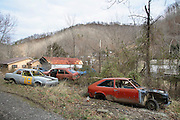 The Hollows, as the valleys of Appalachia are known, are littered with abandoned cars and other signs of poverty.