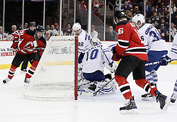 Jan 29, 2010; Newark, NJ, USA; Toronto Maple Leafs defenseman Carl Gunnarsson (36) pulls the puck off the goal line during the second period at the Prudential Center.