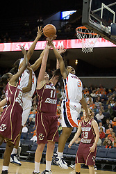 UVA's Paulish Kellum (3) and Siedah Williams (4) battle with BC's Kathrin Ress (11) for a rebound.  The Cavaliers defeated the Eagles 65-63 in overtime at the John Paul Jones Arena in Charlottesville, VA on January 14, 2007.