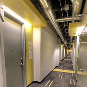 "Hallways in ""The Boss"" building at Roaster's Block apartments after repurposing to residential use of the former Folger's Coffee Plant."