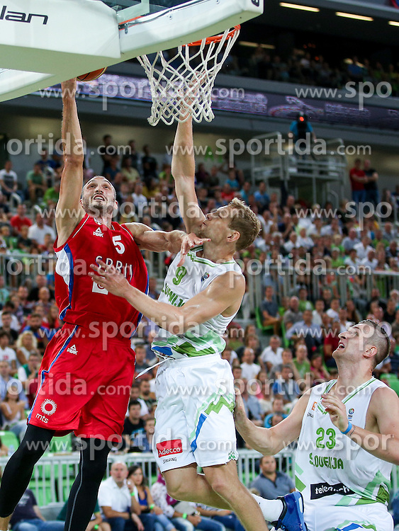 Marko Simonovic of Serbia and Jaka Blazic of Slovenia at friendly basketball match between National teams of Slovenia and Serbia, on August 27 in SRC Stozice, Ljubljana, Slovenia. Photo by Matic Klansek Velej / Sportida August 27, 2015