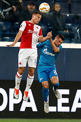 October 4, 2018 - Saint Petersburg, Russia - Robert Mak (R) of FC Zenit Saint Petersburg and Jan Boril of SK Slavia Prague vie for a header during the Group C match of the UEFA Europa League between FC Zenit Saint Petersburg and SK Sparta Prague at Saint Petersburg Stadium on October 4, 2018 in Saint Petersburg, Russia. (Credit Image: © Mike Kireev/NurPhoto/ZUMA Press)