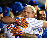 New York Mets Asdrubal Cabrera hugs assistant hitting coach Pat Roessler (6) after hitting a two-run home run during a baseball game, Sept. 1, 2016, in New York. (AP Photo/Kathy Kmonicek)