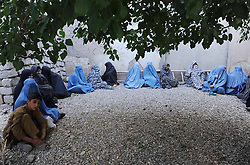 60164570  <br /> Afghan women wait to receive food donated by the rich in Herat province, western Afghanistan,<br /> Saturday 20th July 2013 <br /> Picture by imago / i-Images<br /> UK ONLY