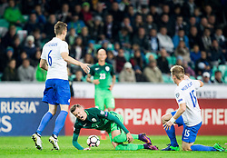 Josip Ilicic of Slovenia faulted by Tomas Hubocan of Slovakia during football match between National teams of Slovenia and Slovakia in Round #2 of FIFA World Cup Russia 2018 qualifications in Group F, on October 8, 2016 in SRC Stozice, Ljubljana, Slovenia. Photo by Vid Ponikvar / Sportida