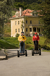 Couple on Segways, each on a Segway, on Angel Island State Park in San Francisco Bay, California, CA. Model released..Photo camari225-70447..Photo copyright Lee Foster, www.fostertravel.com, 510-549-2202, lee@fostertravel.com.