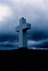 Bald Knob Cross (circ 1977 - original is a transparency) surrounded by storm clouds...**NOTE**  Vertical lines are from original processing.