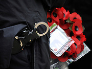© Licensed to London News Pictures. 11/11/2011. London, UK. Police hold items confiscated from the arrested men. Police arrest members of the EDL near the Cenotaph following a Remembrance Day service today (11/11/2011). A large group of EDL members where arrested. Police a. Photo credit : Stephen Simpson/LNP
