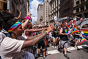 New York, NY - 25 June 2017. New York City Heritage of Pride March filled Fifth Avenue for hours with groups from the LGBT community and it's supporters. Spectators lined Fifth Avenue and enthusiastically greeted each group of marchers.