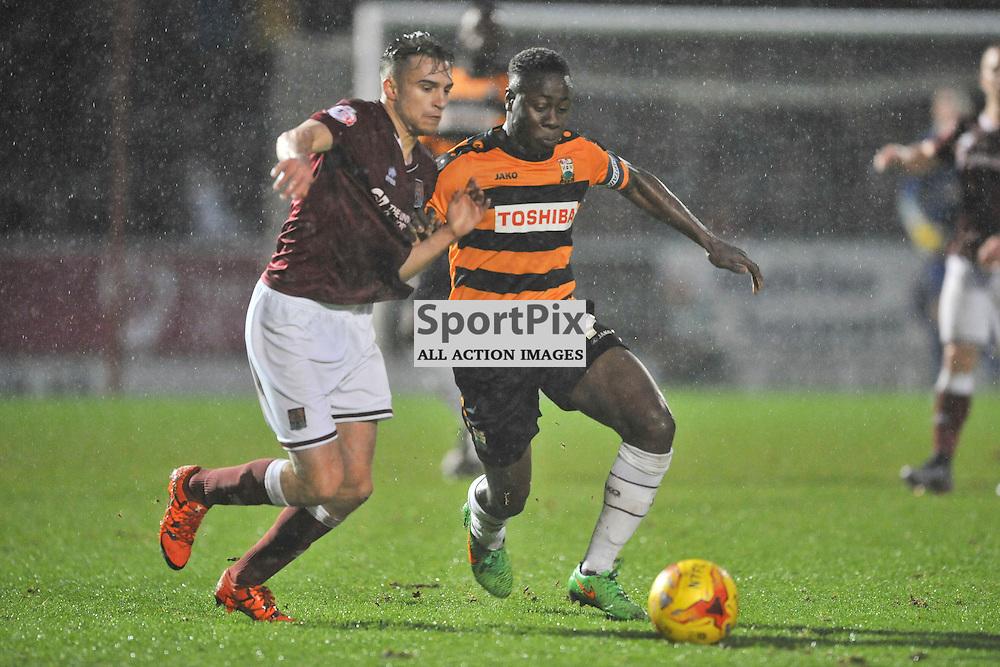 Barnets Andy Yiadom gets past Northamptons Lawson D'Ath, Northampton Town v Barnet FC, Sixfields Stadium, Sky Bet League Two, Saturday 2nd January 2016