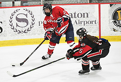 MOON TOWNSHIP, PA - SEPTEMBER 14:  Natalie Fraser #11 of the Robert Morris Colonials passes in front of Courtney Correia #55 of the Toronto Jr. Aeros in the third period during the game at the 84 Lumber Arena on September 23, 2016 in Moon Township, Pennsylvania. (Photo by Justin Berl)