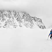 After a massive, late-monsoon storm that dumped nearly three feet of snow on the Gangotri Glacier, David Morton makes his way back down valley.