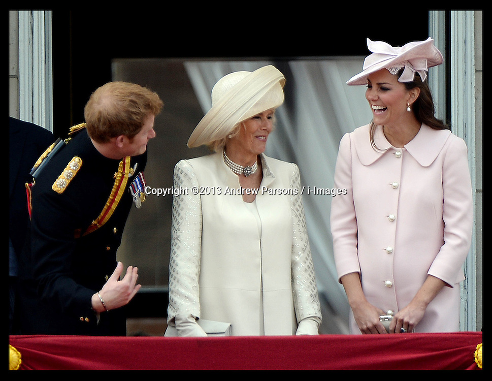 Prince Harry shares a joke with the Duchess of Cornwall and the Duchess of Cambridge on the Balcony of Buckingham Palace during Trooping The Colour, London, United Kingdom,<br /> Saturday, 15th June 2013<br /> Picture by Andrew Parsons / i-Images