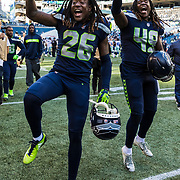 Seattle Seahawks cornerback Shaquill Griffin (26) and Seattle Seahawks linebacker Shaquem Griffin (49) during an NFL regular season football game against the Dallas Cowboys on Sunday, Sept. 23, 2018 in Seattle. The Cowboys won, 24-13. (Ric Tapia via AP)
