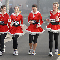 .(left to right) Cynthia Brown, 29, Kara Froula, 29, Elizabeth Hayes, 28, and Kerry Stevenson, 34, run along  Barnard Way in matching Santa outfits during the 33rd Annual Santa Monica - Venice Christmas Run on Saturday, December 11, 2010.