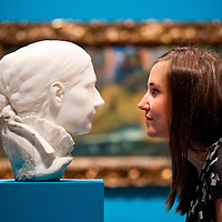 London, UK - 19 June 2013: Hannah Talbot, marketing managar at the Courtauld Gallery, looks at ?Portrait of Mette Gauguin 1879-1880? one of only two marble   sculptures   ever   created   by   Paul Gauguin. The Courtauld Gallery opens tomorrow a special summer display of the most important collection of works in the United Kingdom by the Post-Impressionist master Paul Gauguin (1848-1903), assembled by the pioneering collector Samuel Courtauld (1876-1947).