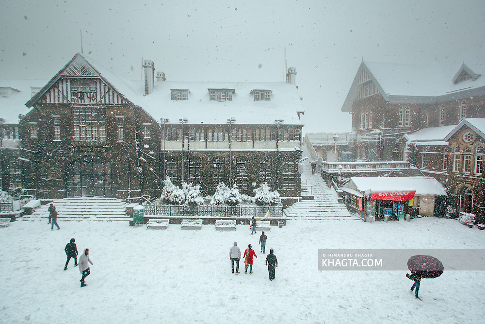 People walking through the snowfall at Shimla, Himachal Pradesh, India