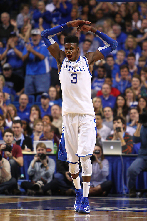 UK forward Nerlens Noel attempts to energize the crowd after a dunk in the sec on half. The University of Kentucky Men's Basketball team hosted Texas A&M , Saturday, Jan. 12, 2013 at Rupp Arena in Lexington . Photo by Jonathan Palmer/Special to the Courier-Journal.