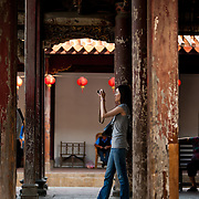 Tourist takes a photo at Longshan Temple, Lugang, Changhua County, Taiwan