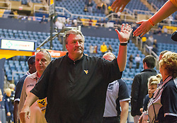 Nov 11, 2016; Morgantown, WV, USA; West Virginia Mountaineers head coach Bob Huggins celebrates with fans after beating Mount St. Mary's Mountaineers at WVU Coliseum. Mandatory Credit: Ben Queen-USA TODAY Sports