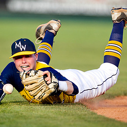 Meridian High School baseball infielder Aahron Coats (6) loses his glasses and the ball while diving for an Eagle High School ground ball during the 5A state high school baseball game held at Memorial Stadium in Boise, Idaho. The runner reached first base on the play. Thursday May 19, 2016