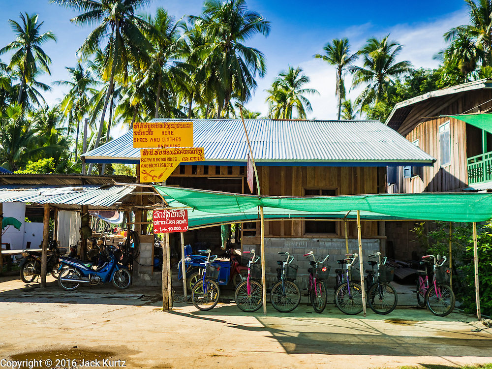 19 JUNE 2016 - DON KHONE, CHAMPASAK, LAOS:  A bicycle rental shop in Don Khone village on Don Khone Island. Don Khone Island, one of the larger islands in the 4,000 Islands chain on the Mekong River in southern Laos. The island has become a backpacker hot spot, there are lots of guest houses and small restaurants on the north end of the island.   PHOTO BY JACK KURTZ