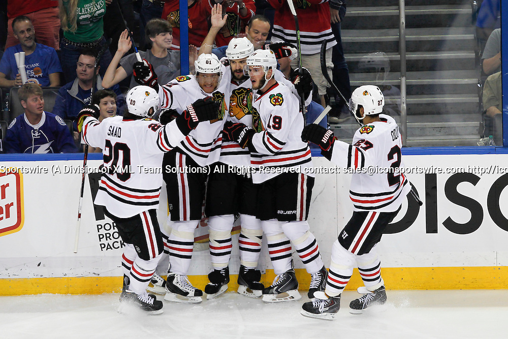 06 June 2015: Chicago Blackhawks defenseman Brent Seabrook (7) celebrates his goal with teammates Jonathan Toews (19), Marian Hossa (81), Brandon Saad (20) and Johnny Oduya (27) in the 3rd period of Game 2 of the Stanley Cup Finals between the Chicago Blackhawks and Tampa Bay Lightning at Amalie Arena in Tampa, FL.
