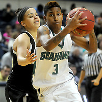 UNCW's Kelva Atkins drives on UNCP's Ashley McCray Sunday November 16, 2014 at Trask Coliseum in Wilmington, N.C. (Jason A. Frizzelle)