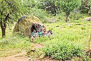 Hadza women and children in the village. The Hadza, or Hadzabe, are an ethnic group in north-central tanzania, living around Lake Eyasi in the Central Rift Valley and in the neighboring Serengeti Plateau.