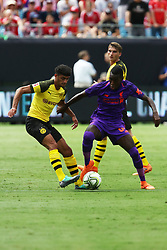 July 22, 2018 - Charlotte, NC, U.S. - CHARLOTTE, NC - JULY 22: Mahmoud Dahoud (19) of Borussia Dortmund and Rafael Camacho (64) of Liverpool fight for control of the ball during the International Champions Cup soccer match between Liverpool FC and Borussia Dortmund in Charlotte, N.C. on July 22, 2018. (Photo by John Byrum/Icon Sportswire) (Credit Image: © John Byrum/Icon SMI via ZUMA Press)