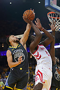 April 30, 2019; Oakland, CA, USA; Golden State Warriors guard Stephen Curry (30) blocks the shot of Houston Rockets center Clint Capela (15) during the second quarter in game two of the second round of the 2019 NBA Playoffs at Oracle Arena.