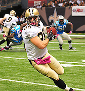 "New Orleans Saints TE David Thomas 85 grabs a pass from QB Drew Brees during the game against the Caoliina Panthers. 3,2010 prior to the Saints game against the Carolina Panthers. The NFL has gone ""Pink"" for October in honor of Breast Cancer Awareness. The Saints went on to win 16-14. John Carney kicked three field goals to help the Saints win. PHOTO©SuziAltman.com"
