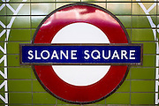 The classic roundel sign for Sloane Square underground tube station sign, London, United Kingdom.  Sloane Square is a small hard-landscaped square on the boundaries of the affluent central London districts of Knightsbridge, Belgravia and Chelsea.