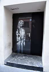 File photo dated June 29, 2018 of artwork by street artist Banksy in Paris, France, on a side street to the Bataclan concert hall where a terrorist attack killed 90 people on November 13, 2015. The mural painted on the emergency exit door of the Bataclan theater has been stolen. A police source said that the door was stolen overnight on Friday January 25, 2019 by thieves in a van. The Bataclan confirmed the theft on Saturday morning. Photo by Alain Apaydin/ABACAPRESS.COM
